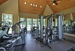 Craftsman Home Gym with Transom window, High ceiling, Yowza fitness captiva elliptical, Concrete tile , Ceiling fan