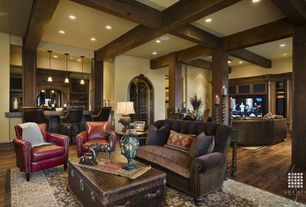 Traditional Living Room with Arched double door, Columns, Exposed beam, High ceiling, Hardwood floors, Area rug