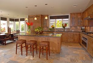 Modern Kitchen with Inset cabinets, L-shaped, Slate Tile, slate tile floors, Stone Tile, Farmhouse harvest dining table