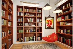 Contemporary Library with Pendant light, Built-in bookshelf, Hardwood floors, interior brick