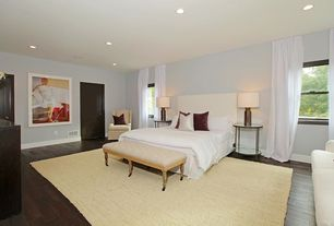 Craftsman Master Bedroom with Hardwood floors, West Elm Tall Simple Upholstered Headboard, Gabby Voltaire Tufted Ottoman