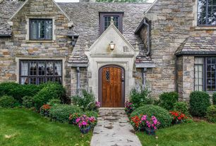 Traditional Front of Home with El dorado stone vinyard trril rough cut, Pathway, Glass panel door
