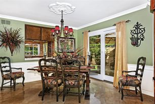 Traditional room with Chandelier, Wainscotting, Crown molding, sliding glass door, Wall sconce, travertine tile floors