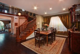 Traditional Dining Room with Hardwood floors, Casement, Crown molding, Standard height, can lights, Built-in bookshelf