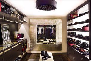 Modern Closet with Hardwood floors, flush light, Adesso timpani drum light, Built-in bookshelf