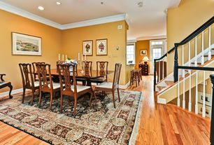 Traditional Dining Room with can lights, Standard height, Crown molding, Hardwood floors