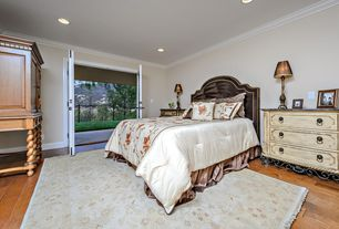 Mediterranean Guest Bedroom with can lights, French doors, Wainscotting, Hardwood floors, flush light, Crown molding