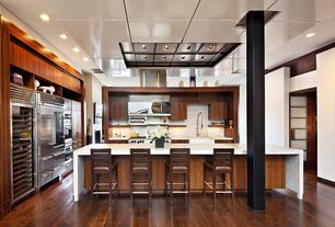 Contemporary Kitchen with Marble waterfall countertop, Hardwood floors, Complex Marble, European Cabinets, Farmhouse sink