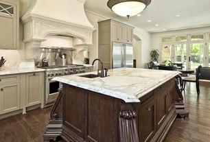 Traditional Kitchen with Flat panel cabinets, Transom window, Undermount sink, Inset cabinets, Crown molding, Custom hood