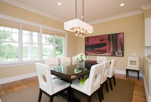Contemporary Dining Room with Mobital Enigma Dining Table, Crown molding, Pendant light, Hardwood floors