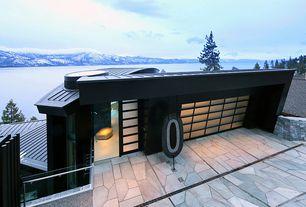 Contemporary Garage with Concrete floors, Shoji door