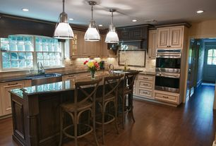 Country Kitchen with Raised panel, Glass panel door, Slate Tile, Stone Tile, Kitchen island, Glass panel, Pendant light