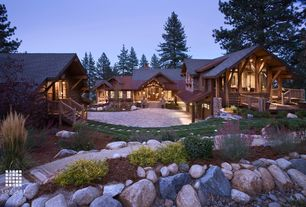 Rustic Exterior of Home with Accent landscape lighting, Raised beds, Brick and tone paved pathway