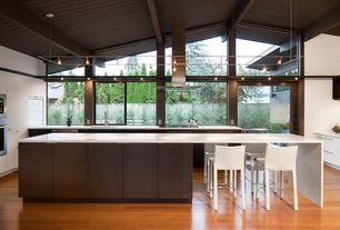 Contemporary Kitchen with European Cabinets, Breakfast bar, flush light, Corian counters, L-shaped, Exposed beam, Flush