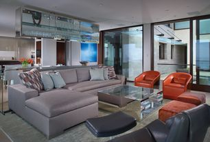 Contemporary Living Room with sandstone tile floors