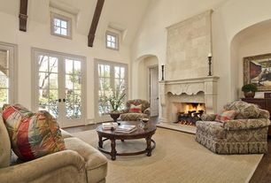 Traditional Living Room with Exposed beam, Fireplace, Laminate floors, Wall sconce, High ceiling, interior wallpaper