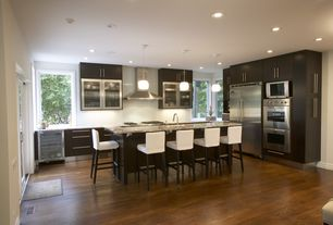 Contemporary Kitchen with L-shaped, 38-bottle stainless steel wine refrigerator, European Cabinets, Simple granite counters