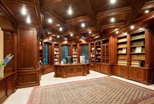 Traditional Home Office with Built-in bookshelf, Arched window, Box ceiling, Laminate floors, Wood paneling