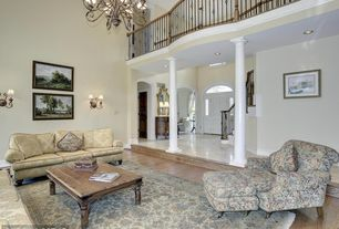 Traditional Living Room with Balcony, Chandelier, High ceiling, Wall sconce, Hardwood floors, Sunken living room, Columns