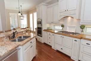 Traditional Kitchen with Framed Partial Panel, Beech edge wood countertop, Subway Tile, Crown molding, Multiple Sinks