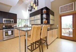 Contemporary Kitchen with French doors, Stone Tile, Breakfast bar, Bamboo floors, Pendant light, Concrete counters, U-shaped