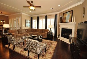 Modern Living Room with Crown molding, Ceiling fan, Hardwood floors, flush light