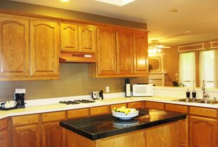 Traditional Kitchen with Standard height, can lights, Multiple Sinks, stone tile counters, L-shaped, partial backsplash