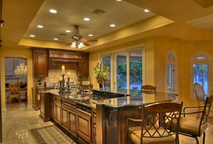 Traditional Kitchen with Breakfast bar, Arched window, Vinyl floors, Ceiling fan, Transom window, Undermount sink, One-wall