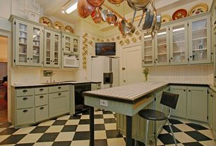 Eclectic Kitchen with Breakfast bar, Glass panel, spcialty tile counters, Vinyl floors, Wainscotting, flush light, U-shaped