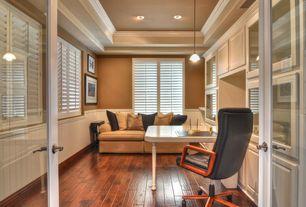 Modern Home Office with Pendant light, Wainscotting, specialty window, Standard height, Built-in bookshelf, can lights