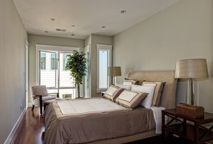 Contemporary Guest Bedroom with Standard height, picture window, can lights, Laminate floors, Casement