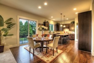 Contemporary Dining Room with Pendant light, Carpet, Laminate floors