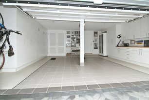 Contemporary Garage with six panel door, can lights, Interlocking Pavers, stone tile floors, Columns, Standard height