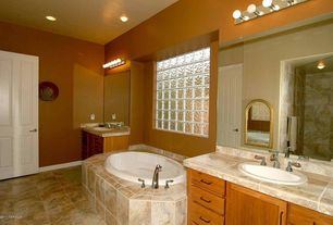 Craftsman Full Bathroom with wall-mounted above mirror bathroom light, specialty door, partial backsplash, can lights, Shower