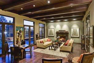 Eclectic Living Room with French doors, Exposed beam, York Sofa, High ceiling, Hardwood floors, Transom window