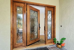 Traditional Front Door with exterior tile floors, exterior concrete tile floors, Glass panel door