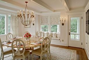 Traditional Dining Room with Standard height, Chandelier, Hardwood floors, Window seat, Exposed beam, picture window