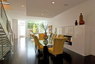 Contemporary Dining Room with insert fireplace, Hardwood floors, High ceiling, Fireplace, can lights