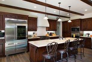 Traditional Kitchen with Flat panel cabinets, specialty door, Kitchen island, Exposed beam, Breakfast bar, Undermount sink