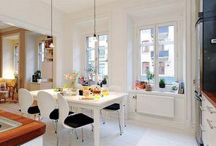 Traditional Dining Room with Pendant light, Cb2 Aqua Virgo Dining Table, Hardwood floors, Ikea: lansa kitchen hardware