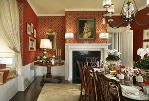 Traditional Dining Room with interior wallpaper, brick fireplace, Fireplace, Crown molding, specialty window, Wainscotting
