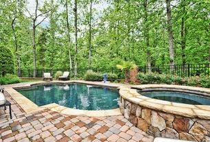 Traditional Hot Tub with exterior stone floors, Pathway, Fence, Pool with hot tub