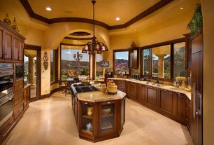 Mediterranean Kitchen with Simple granite counters, Raised panel, Kitchen island, Pendant light, Paint, Breakfast nook, Flush