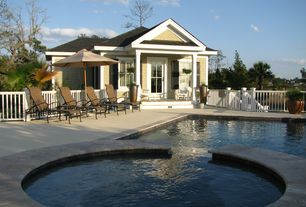 Traditional Swimming Pool with Pathway, French doors, exterior stone floors