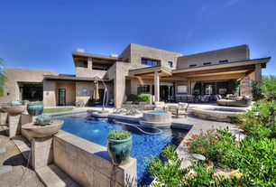 Contemporary Swimming Pool with Pathway, exterior stone floors, Outdoor kitchen, French doors, Lap pool