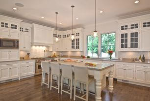 Traditional Kitchen with Kitchen island, L-shaped, Crown molding, Glass panel, Undermount sink, Hardwood floors, Custom hood