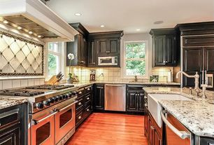 Traditional Kitchen with Farmhouse sink, L-shaped, Undermount sink, Raised panel, Inset cabinets, full backsplash, can lights