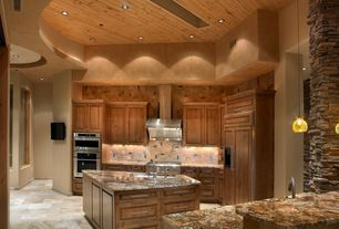 Rustic Kitchen with Raised panel, stone tile floors, double wall oven, Stone Tile, Wall Hood, full backsplash, High ceiling