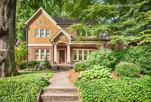 Traditional Exterior of Home with Pathway, Fence, specialty window, Wood shingle, Glass panel door, French doors