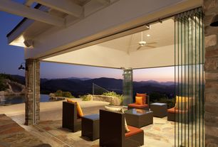 Contemporary Patio with exterior stone floors, sliding glass door, Raised beds, Pathway